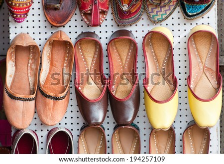 traditional indian shoes for selling on a market in rajasthan - stock photo