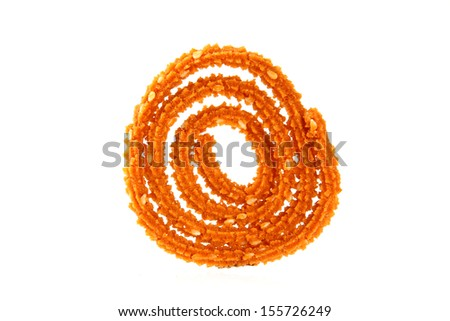 Traditional indian snack - chakali, isolated on white. - stock photo