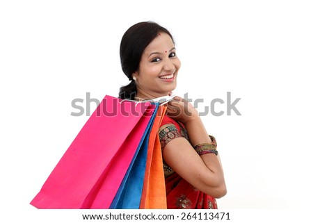 Traditional Indian woman holding shopping b - stock photo