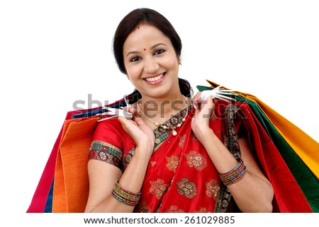 Traditional Indian woman holding shopping bags  - stock photo