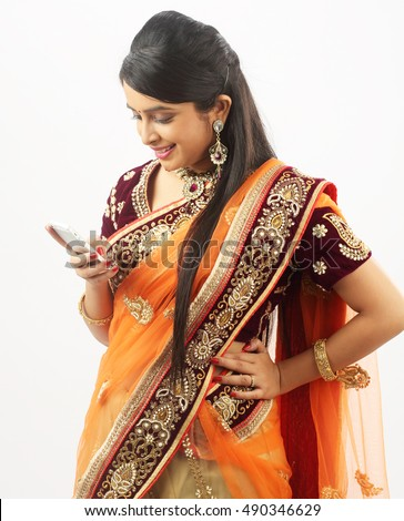 Traditional Indian woman looking in cellphone