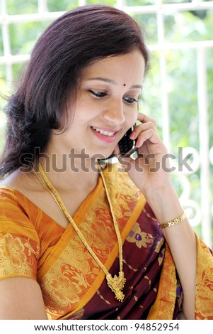 Traditional Indian woman talking on cellphone - stock photo