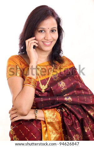 Traditional Indian woman talking on mobile phone