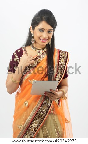 Traditional Indian woman using a tablet