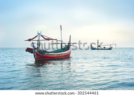 Traditional indonesian fishing boats in the ocean, Jawa island, Indonesia - stock photo