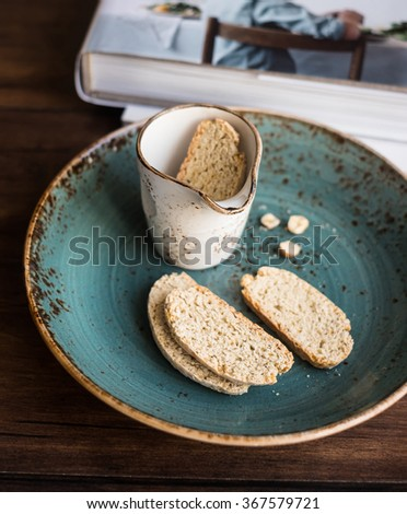 Traditional Italian biscotti cookies (cantucci) on a wooden table, selective focus - stock photo