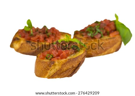 traditional italian bruschetta with chopped tomatoes in olive oil and basil garnishing