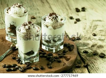 Traditional Italian dessert tiramisu in glass, selective focus - stock photo