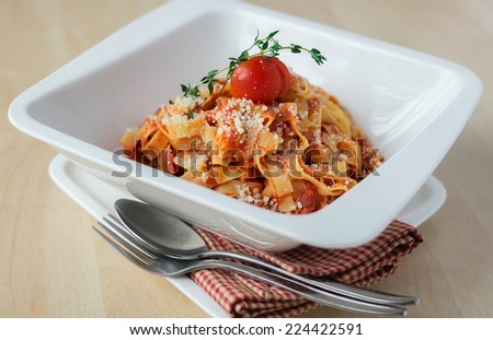 Traditional italian dish tagliatelle pasta bolognese with minced beef meat and vegetables in a bowl, selective focus - stock photo