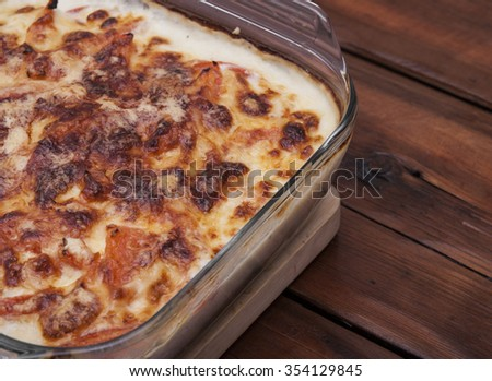 Traditional Italian lasagna cooked in a glass pan - stock photo