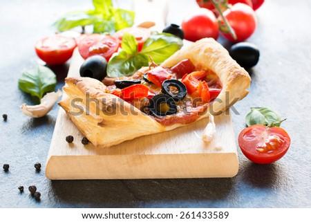 Traditional Italian mini pizza on wooden board,selective focus  - stock photo