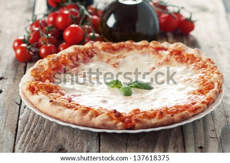 Traditional italian pizza with mozzarella and basil, selective focus - stock photo