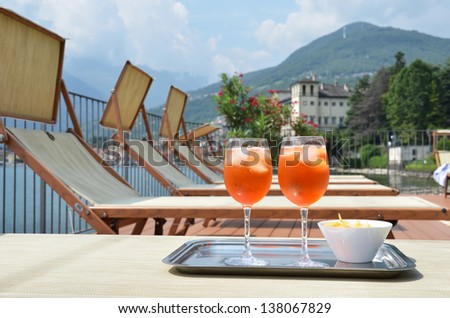 Traditional Italian Spritz cocktail against lake Como, Italy - stock photo