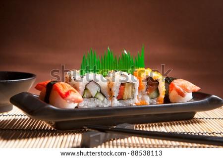 Traditional Japanese food Sushi. Closeup japanese sushi on a bamboo napkin. Sushi collection - stock photo