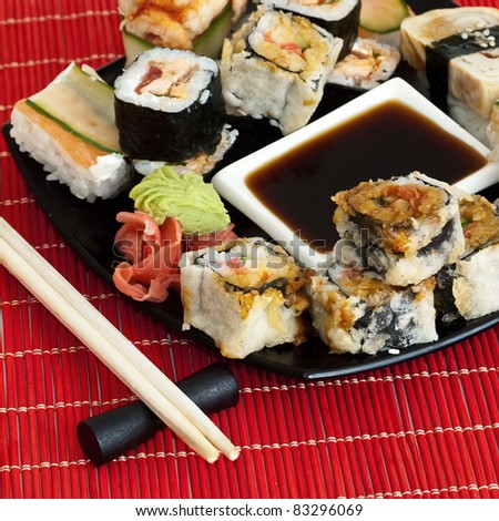 Traditional Japanese food Sushi. Closeup japanese sushi on a black plate. Sushi collection - stock photo