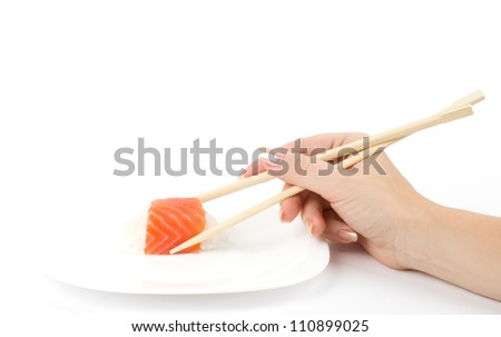 Traditional Japanese food Sushi in hand on white background - stock photo