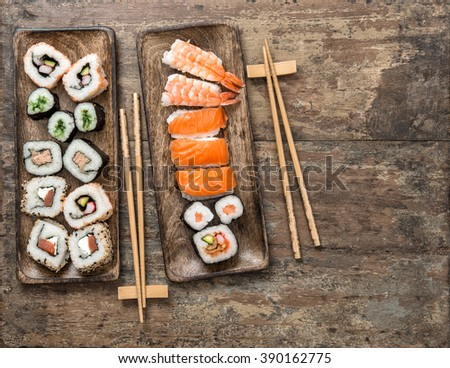 Traditional japanese food. Sushi rolls, maki, nigiri on rustic wooden background. Seafood - stock photo