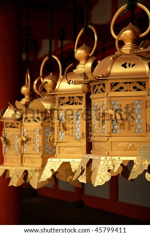 Traditional Japanese golden lanterns in temple - stock photo