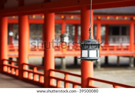 Traditional Japanese Lantern At Itsukushima Shrine, Miyajima, Japan.