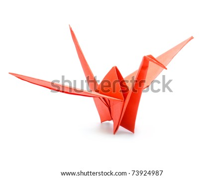 Traditional Japanese origami crane made from red paper over white background - stock photo