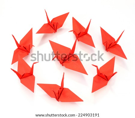 Traditional Japanese origami crane made of red paper over white background  - stock photo