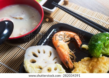 Traditional Japanese soup Chawanmushi and fried tofu tempura. - stock photo