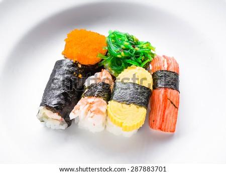 traditional Japanese sushi fresh and tasty on white. - stock photo