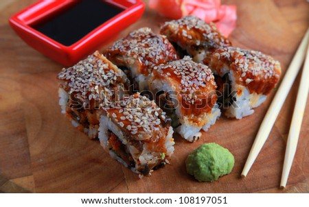 Traditional Japanese Sushi rolls with avocado,eel , caviar and rice - stock photo