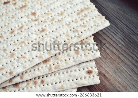 Traditional jewish bread matzo on wooden table - stock photo