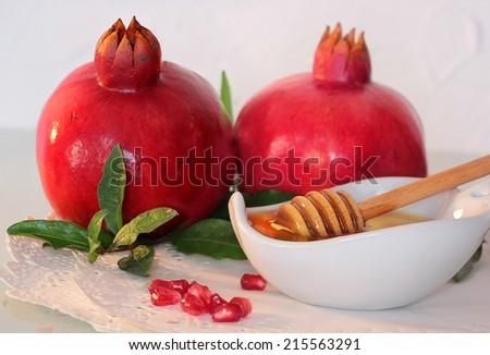 traditional jewish food, honey and pomegranate for the holiday of Rosh Hashanah - stock photo