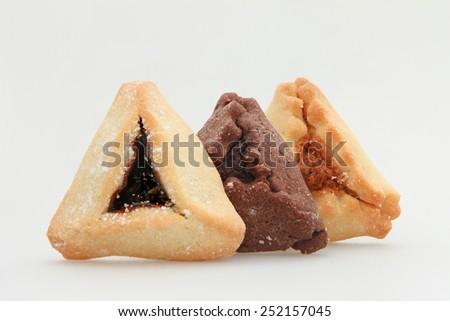 Traditional Jewish holiday food -  Purim Hamantaschen - stock photo