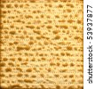 Traditional Jewish Matzo sheet useful as background - stock photo