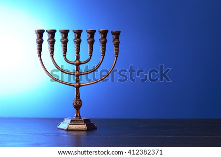 Traditional jewish menorah on nice blue background - stock photo