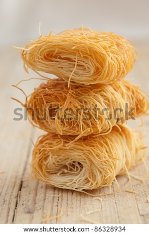 Traditional kadaif dough before being poured with syrup - stock photo