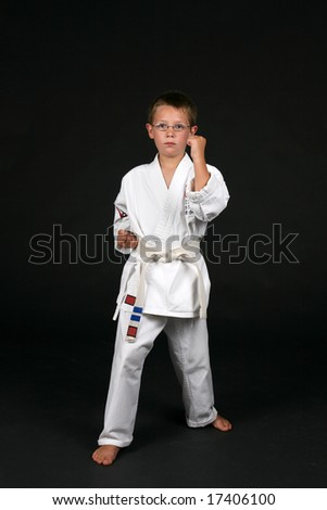 traditional karate student demonstrates double bone block and right stance