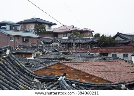Traditional Korean style roof tile at Bukchon Hanok Village in Seoul, South Korea - stock photo