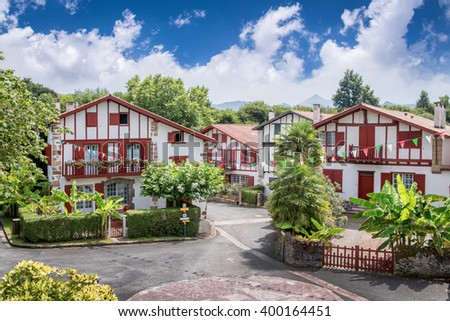 Traditional Labourdine houses in the village of Espelette, Basque country, France - stock photo