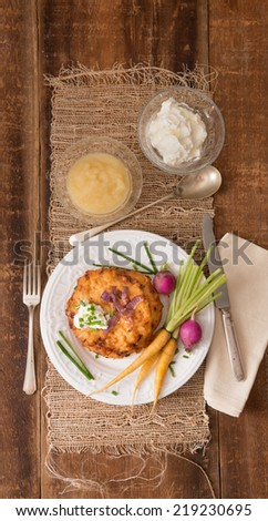 Traditional lakes, or potato pancakes are served during the Jewish holiday Hanukkah. - stock photo