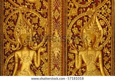 Traditional laos style door of Buddhist church - stock photo