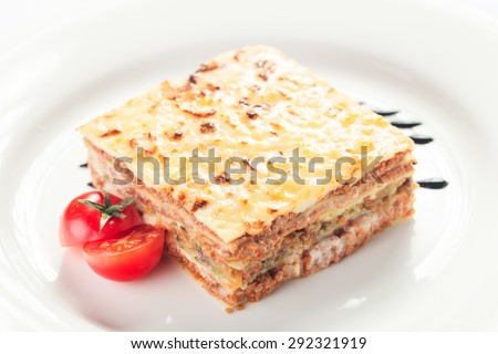 Traditional lasagna made with minced beef bolognese sauce isolated on white background - stock photo