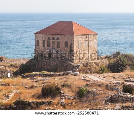 Traditional Lebanese house over the Mediterranean sea near ancient ruins, Byblos, Lebanon. - stock photo