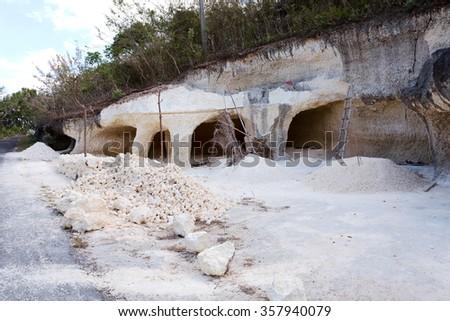 traditional limestone mining tunnel in Nusa Penida island, Bali Indonesia - stock photo