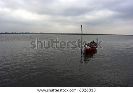 Traditional little fishing boat of Aveiro (Portugal) in a cloudy day