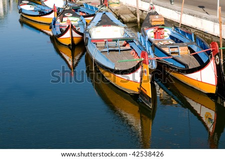 Traditional little fishing boats of Aveiro (Portugal) - stock photo