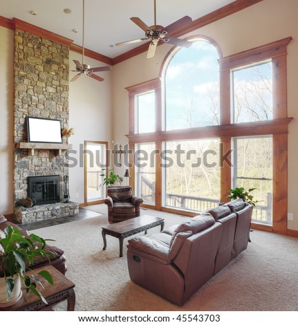Traditional living room interior with a high ceiling and large windows. Square format. - stock photo