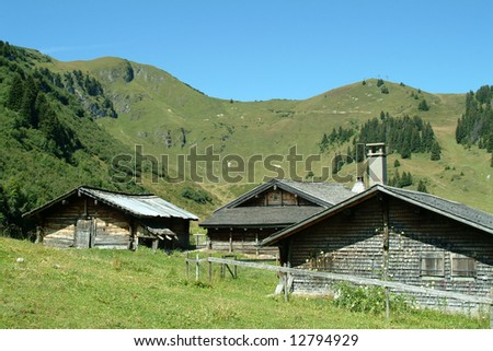 Traditional log cabins in the Swiss mountains with blue sky
