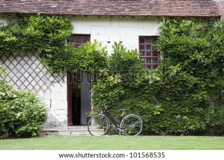 traditional Loire valley house with a bicycle near the entrance, France - stock photo