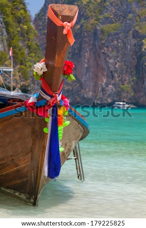 Traditional longtail boat in the famous Maya bay of Phi-phi Leh island, Thailand - stock photo