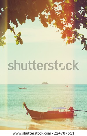 Traditional longtail boat, vintage toned and stylized - stock photo