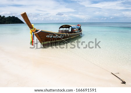 Traditional longtail boats in bay of Lipe island, Thailand - stock photo